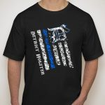 "Totally custom ""Distressed Flag"" T-shirts exclusively from Detroit Holster featuring the ""Thin Blue Line"" stripe.  MADE IN USA!  Also remember that Detroit Holster donates approximately 10% to charities that support military, law enforcement, the hungry and more – all thanks to your purchases. Thank you!  Order yours HERE."